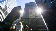 Banks tower above pedestrians in Toronto's financial district. (Kevin Van Paassen/Kevin Van Paassen/The Globe and)