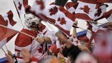 A sea of Canadian flags are seen during in Edmonton on Thursday, Dec. 29, 2011. (Nathan Denette/THE CANADIAN PRESS)
