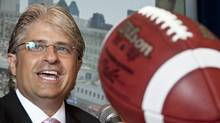 Montreal Alouettes general manager Jim Popp smiles after announcing he has signed an extension to his contract with the Alouettes through the 2014 season during a news conference Wednesday August 4, 2010 in Montreal. (Paul Chiasson/THE CANADIAN PRESS)