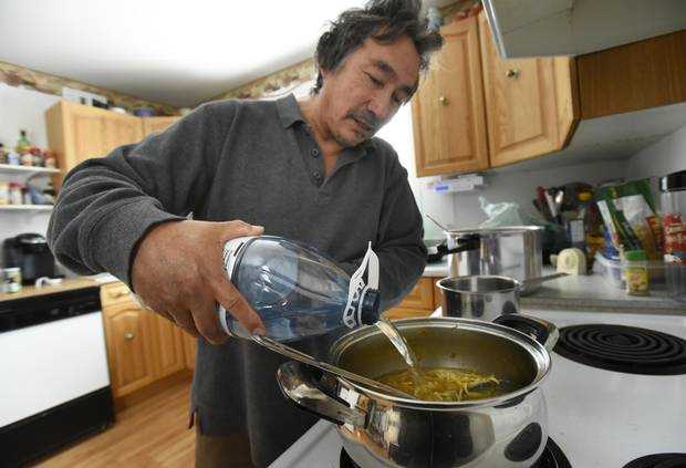 Blain Commanda of the Serpent River First Nation uses bottled water while cooking soup on Dec 20 2016. The Serpent River First Nation, located west of Sudbury, Ont., is still under a Do Not Drink water advisory even though the community has a new water treatment plant.