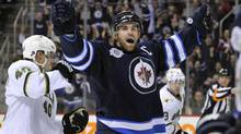 Winnipeg Jets Andrew Ladd celebrates his goal against the Dallas Stars during the second period of their NHL game in Winnipeg March 14, 2012. (FRED GREENSLADE/REUTERS)