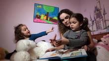 Doctors thing Nathalie Corneau's daughter Marie-Ève, right, with sister Zoe, left, may suffer from an undiagnosed neurological disorder. (Dave Chan for The Globe and Mail)