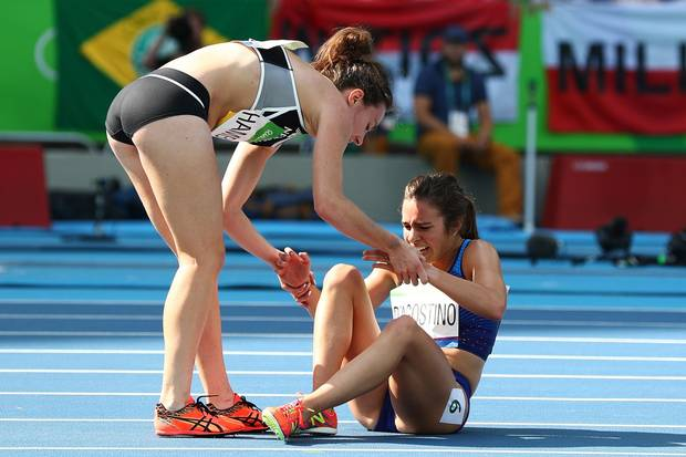 Abbey D'Agostino of the United States (R) is assisted by Nikki Hamblin of New Zealand after a collision during the Women's 5,000-metre Round 1 - Heat 2 on Day 11 of the Rio 2016 Olympic Games at the Olympic Stadium on August 16, 2016 in Rio de Janeiro, Brazil.