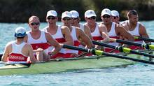 Canada's men's eight rowing team members Gabriel Bergen, right to left, Douglas Csima, Rob Gibson, Conlin McCabe, Malcolm Howard, Andrew Byrnes, Jeremiah Brown, Will Crothers, and cox Brian Price catch their breath after placing second in the repechage and earning themselves a spot in the Olympic finals at Eton Dorney at the 2012 Summer Olympics in Dorney, England on Monday, July 30, 2012. (The Canadian Press)