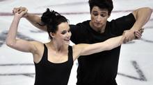 Tessa Virtue (L) and Scott Moir of Canada skate during a practice session at Skate Canada International in Windsor October 25, 2012. (MIKE CASSESE/REUTERS)