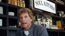 Rock star Jon Bon Jovi sits in the Soul Kitchen restaurant in Red Bank, N.J., Wednesday, Oct. 19, 2011. Diners pay whatever they're able to. (Mel Evans/Mel Evans/AP)