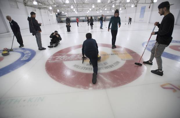 A group of refugees took part in a day trip to the Royal Canadian Curling Club where they had their first curling experience, on March 15, 2017.