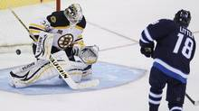 The Winnipeg Jets' Bryan Little beats Boston Bruins goaltender Chad Johnson in the shootout in Winnipeg on Thursday, April 10, 2014. (JOHN WOODS/THE CANADIAN PRESS)