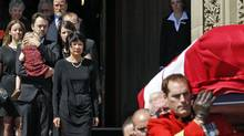 With his widow, Toronto MP Olivia Chow, and children looking on, Jack Layton's casket is carried out of Centre Block on Aug. 25, 2011. The late Opposition Leader had been lying in state for two days on Parliament Hill. (BLAIR GABLE/REUTERS)