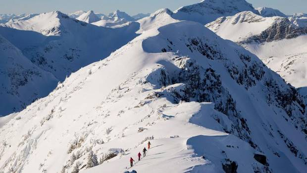 Backcountry enthusiasts are being warned to stay home this weekend as the avalanche risk hits extreme in some parts of the province, for the first time this winter. Backcountry skiers are dwarfed by the mountains as they make their way along a mountain ridge near McGillivray Pass Lodge located in the southern Chilcotin Mountains of British Columbia, Tuesday, Jan. 10, 2012. THE CANADIAN PRESS/Jonathan Hayward