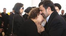 Iran's President Mahmoud Ahmadinejad (R) offers his condolences to Elena Frias, mother of Venezuela's late President Hugo Chavez, during the funeral service at the Military Academy in Caracas March 8, 2013, in this picture provided by the Miraflores Palace. (HANDOUT/REUTERS)