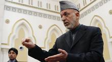 Afghan President Hamid Karzai speaks during a news conference in Kabul. (Mohammad Ismail/Reuters/Mohammad Ismail/Reuters)