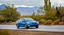 The 2014 Forte's design is low, and wide and sleek. (Kia)