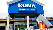 A man carries building supplies from a Rona store in Toronto on Tuesday, July 31, 2012. Rona Inc. has rejected a $1.76-billion unsolicited takeover offer from U.S.-based Lowe's Companies, which says it's still interested in buying Canada's largest home-improvement chain. (Nathan Denette/THE CANADIAN PRESS)