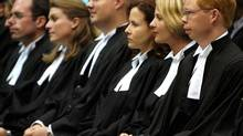 Candidates for the bar listen during a Law Society of Upper Canada ceremony held at the London Convention Centre. (MORRIS LAMONT/CP)