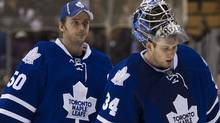 Toronto Maple Leafs goalies Jonas Gustavsson, left, and James Reimer, right, leave the ice after being defeated by the Washington Capitals 4-2 in NHL hockey action in Toronto on Saturday, Feb. 25, 2012. THE CANADIAN PRESS/Nathan Denette (Nathan Denette/CP)