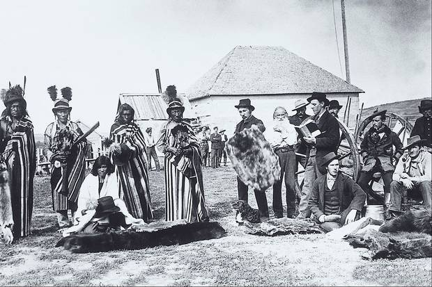 Fort Pitt, NWT, 1884: Plains Cree chief Big Bear and his sons trade with European settlers.