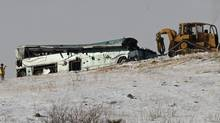 A tour bus that careened off a mountain highway and plunged down a snow-covered slope, killing nine passengers and injuring at least 27 others is recovered in Pendleton, Ore., on Dec. 31, 2012. (STEVE DIPAOLA/REUTERS)