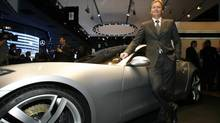 Henrik Fisker, owner of Fisker Automotive, poses next to a Karma at the North American International Auto Show Monday, Jan. 14, 2008, in Detroit. (Gary Malerba/ASSOCIATED PRESS)