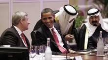 Prime Minister Stephen Harper talks with United States President Barack Obama as Saudi Arabia's King and Prime Minister Abdallah Bin Abd al-Aziz Al Saud looks on during the G20 Summit in Toronto, June 26, 2010. (JIM YOUNG/REUTERS/Jim Young)
