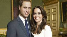 Britain's Prince William and Kate Middleton pose in an official engagement portrait taken by Mario Testino iat St James's Palace in London on Nov. 25, 2010. (HO/REUTERS)