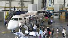 WestJet has converted an option for five Q400 aircraft to a firm order. The turboprop aircraft will be delivered in 2015. (Larry MacDougal/THE CANADIAN PRESS)