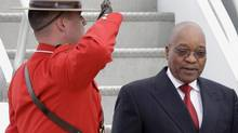 A Royal Canadian Mounted Police officer salutes as South African President Jacob Zuma (R) arrives at Pearson International Airport to attend the G8 and G20 Summits in Toronto June 24, 2010. Zuma is scheduled to participate in the group of eight outreach session during the G8 Summit in Huntsville. (MIKE CASSESE/REUTERS)