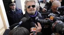 Five Star Movement leader and comedian Beppe Grillo speaks with media after casting his vote at the polling station in Genoa Feb. 25, 2013. (Giorgio Perottino/Reuters)