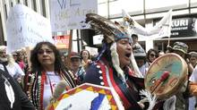 Nadleh Whut'en Chief Martin Louie (R) joins protesters outside the Enbridge Inc. annual general meeting of shareholders in Toronto. (MIKE CASSESE/REUTERS)