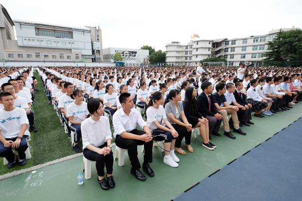 High school students attend the opening ceremony of a new term at their school in Beijing in September, 2016.