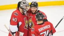 Ottawa Senators goalie Robin Lehner (40), right wing Bobby Ryan and defenceman Mark Borowiecki (74) celebrate their win against the Florida Panthers at the Canadian Tire Centre. The Senators defeated the Panthers 3-2. (MARC DEROSIERS/USA TODAY SPORTS)
