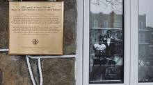 A photo of late baseball player Jackie Robinson and his wife Rachel sits in a window beside a newly unveiled plaque outside the former residence of Jackie Robinson in Montreal, February 28, 2011. (CHRISTINNE MUSCHI/REUTERS)