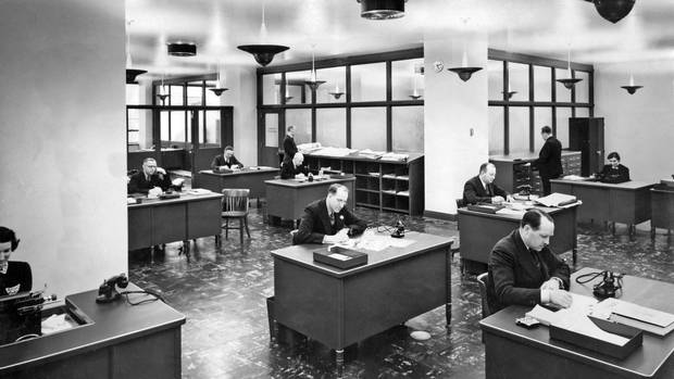 As times change, so do the principles of what makes a sensible office setting. Above, Globe and Mail workers go about their business at their island-like work spaces shortly after moving into their new office at the William H. Wright Building in Toronto in 1938.
