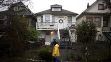 A row of tilting house on East 17th Avenue near Prince Edward Street in East Vancouver, British Columbia, Friday, December 27, 2013. (Rafal Gerszak for The Globe and Mail)
