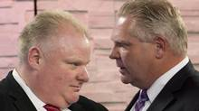 In this March, 26, 2014, file photo, Mayor Rob Ford, left, listens to his brother and campaign manager Doug Ford, right, during a commercial break as Rob Ford takes part in a live television mayoral debate in Toronto. Rob Ford's lawyer said Wednesday, April 30, 2014, that the Toronto mayor will take a leave of absence to seek help for substance abuse. (Nathan Denette/The Canadian Press/AP)