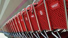 Shopping carts sit parked outside a Target store in Marlborough, Mass. (Bill Sikes/AP)