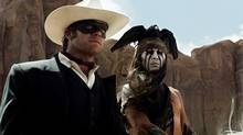 Armie Hammer, left, as The Lone Ranger, and Johnny Depp, as Tonto, in a scene from The Lone Ranger. (Peter Mountain/THE CANADIAN PRESS)