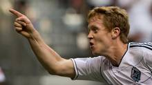 Vancouver Whitecaps' Barry Robson, of Scotland, celebrates after scoring the team's second goal against the Los Angeles Galaxy during the first half of an MLS soccer game in Vancouver, B.C., on Wednesday July 18, 2012. (DARRYL DYCK/THE CANADIAN PRESS)