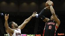 Toronto Raptors guard DeMar DeRozan (10), shoots over Atlanta Hawks guard Willie Green (33), in the first half of their NBA basketball game in Atlanta, Georgia April 15, 2012. (Reuters)