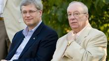 Prime Minister Stephen Harper, left, sits next to Senator Jacques Demers at a Conservative party rally in the Montreal borough of Dollard des Ormeaux, Wednesday, September 1, 2010. THE CANADIAN PRESS/Graham Hughes (Graham Hughes)