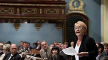 Quebec Premier Pauline Marois responds to Opposition questions as the legislature resumes for its fall session Tuesday, September 17, 2013, at the legislature in Quebec City. (Jacques Boissinot/THE CANADIAN PRESS)