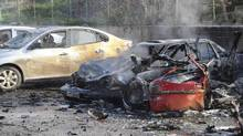 Damaged cars are seen after an explosion at Cilvegozu border gate on the Turkish-Syrian border in Hatay province February 11, 2013, in this picture taken by Anadolu Agency. (ANADOLU AGENCY/REUTERS)