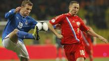 Russia's Vladimir Bystrov (R) fights for the ball with Azerbaijan's Maksim Medvedev during their 2014 World Cup qualifying soccer match at the Luzhniki stadium in Moscow October 16, 2012. (MAXIM SHEMETOV/REUTERS)