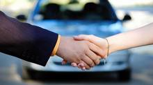 Buying a used car. (Photos.com)