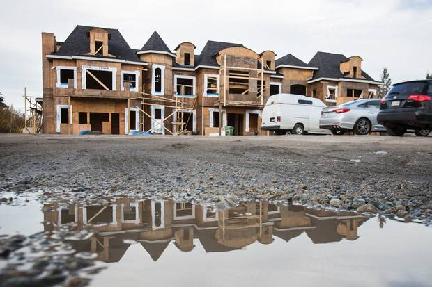 The smaller of Mr. Shi's mansions is still under construction. The value of Mr. Shi's 13 properties, which have no mortgages, shot up by millions more during Vancouver's recent market frenzy.