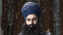 Balpreet Singh, lawyer at the World Sikh Organization of Canada, poses in front of the National Assembly in Quebec City Tuesday January 18, 2011. Singh was denied entrance by Quebec National Assembly security because he insisted on wearing ceremonial kirpans. (Francis Vachon/Francis Vachon)