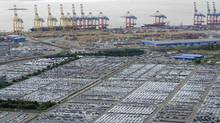 Cars for export stand in a parking area at a shipping terminal in the harbour of the German northern town of Bremerhaven. Export vehicles from Europe are transported to all parts of the world through Bremerhaven, which is one of the biggest automobile ports in the world. (FABIAN BIMMER/REUTERS)