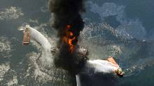 This April 21, 2010 file photo shows the Deepwater Horizon oil rig burning after an explosion in the Gulf of Mexico, off the southeast tip of Louisiana. Decisions intended to save time and money created an unreasonable amount of risk that triggered the largest offshore oil spill in U.S. history, a disaster that could happen again without significant reforms by industry and government, the presidential panel investigating the BP blowout concluded Wednesday, Jan. 5, 2011. (Gerald Herbert/AP/Gerald Herbert/AP)