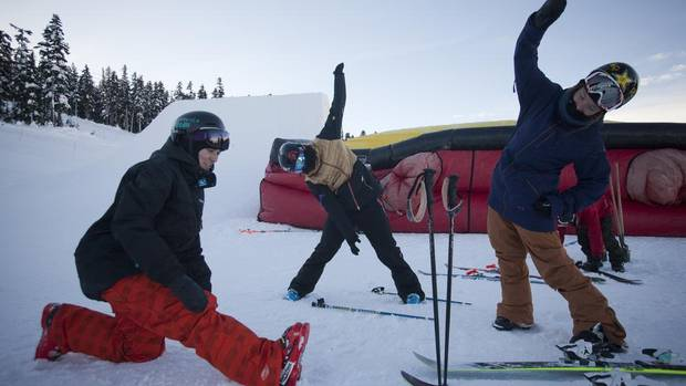 (L-R) Keltie Hansen, Roz Groenewoud and Megan Gunning of the Canadian Freestyle Ski team stretch before training at Whistler-Blackcomb in Whistler, British Columbia on January 2, 2013. (BEN NELMS/The Globe and Mail)