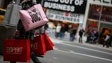 A shopper carries bags up Fifth Avenue on Black Friday November 27, 2009 in New York City (David Goldman/Getty Images)